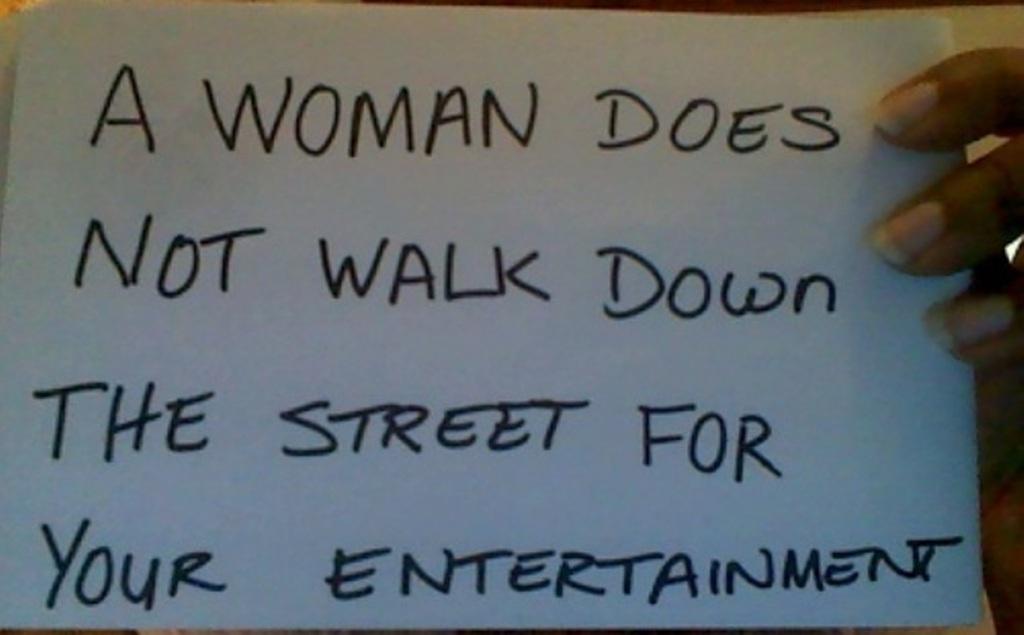 feminism (sexism) - street harassment (a woman does not walk down the street)